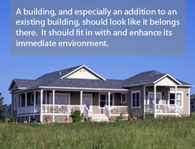 A building, and especially an addition to an existing building, should look like it belongs there.  It should fit in with and enhance its immediate environment.